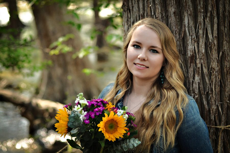 Outdoor senior portrait of girl with flowers