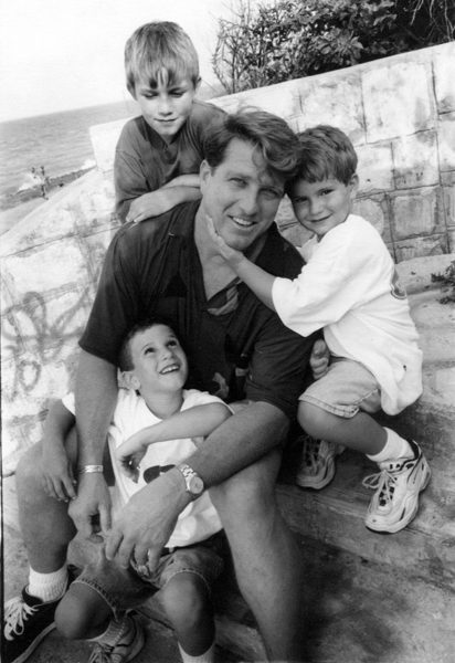 black & white portrait of man with children